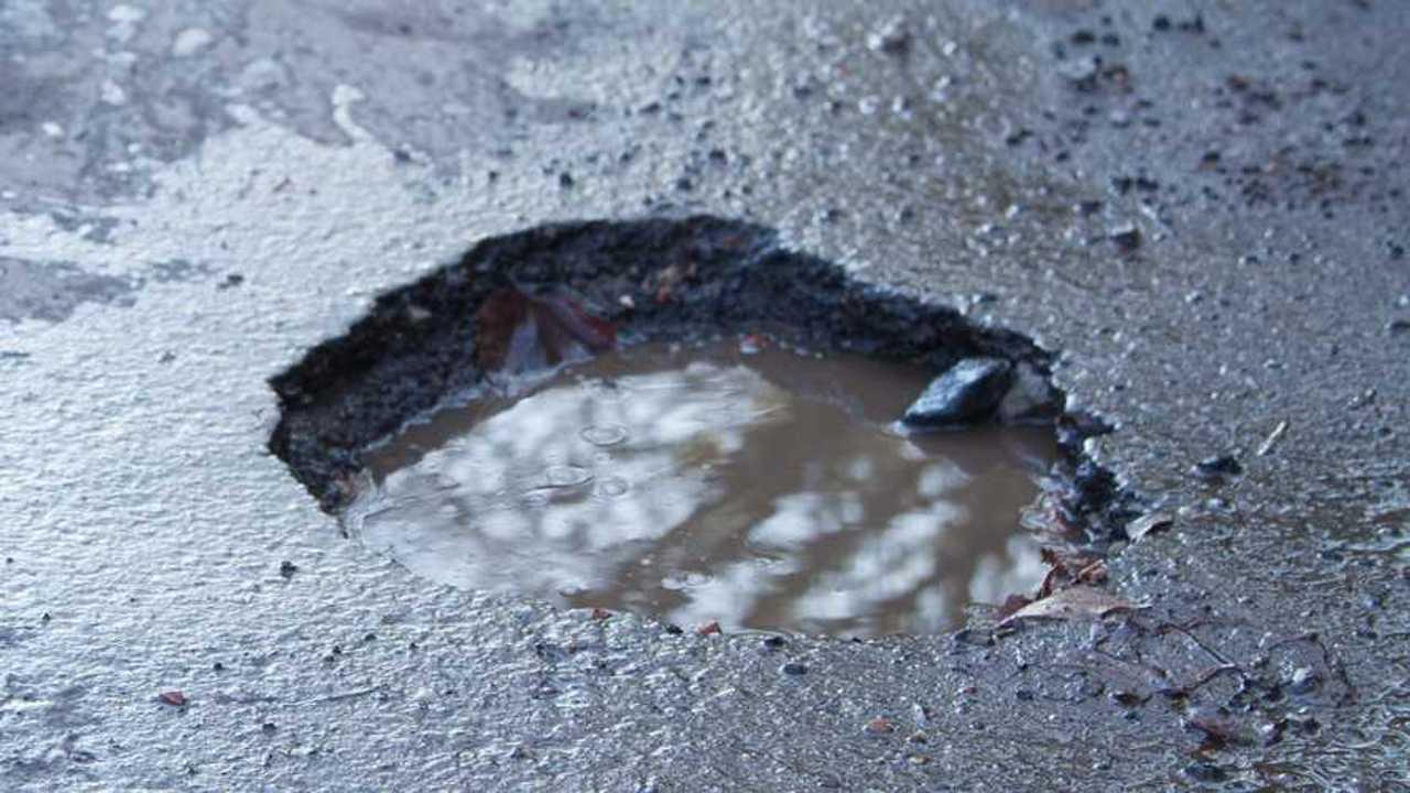 Large deep pothole in UK road