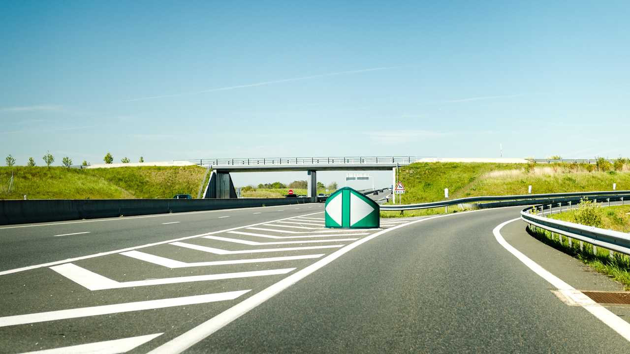 French autoroute highway exit with security differentiator and overpass