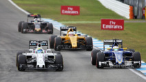 Felipe Massa, Williams FW38 and Marcus Ericsson, Sauber C35 battle for position