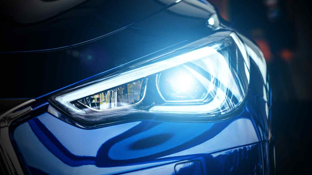 Closeup of BMW blue xenon lamp headlight