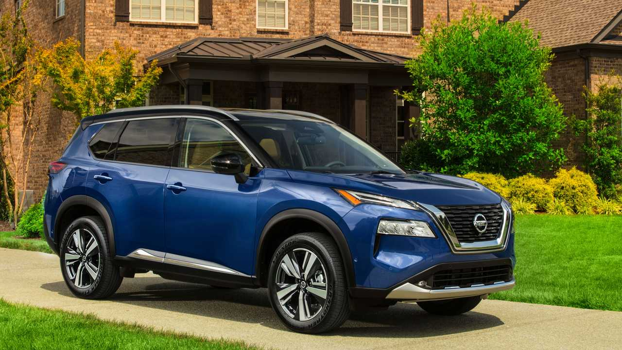 2021 Nissan Rogue posing in front of a house