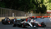 Lewis Hamilton, Mercedes AMG F1 W07 Hybrid and Romain Grosjean, Haas F1 Team VF-16 battle for position