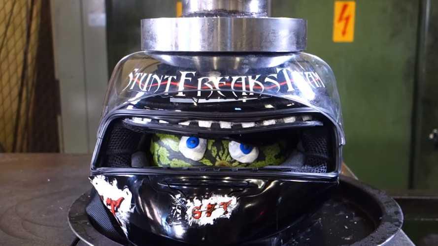 Watch These Finns Crush Some Helmets In A Hydraulic Press