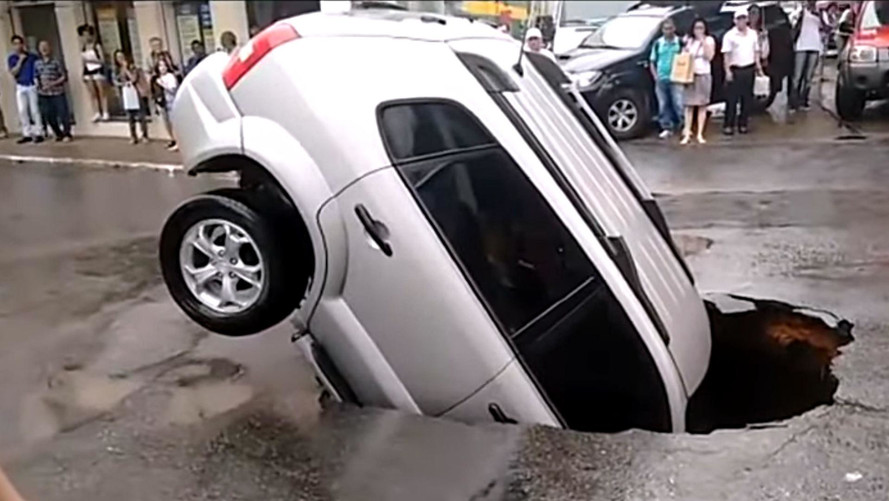 SUV Goes Vertical In Massive Brazilian Sinkhole, Dog Blamed