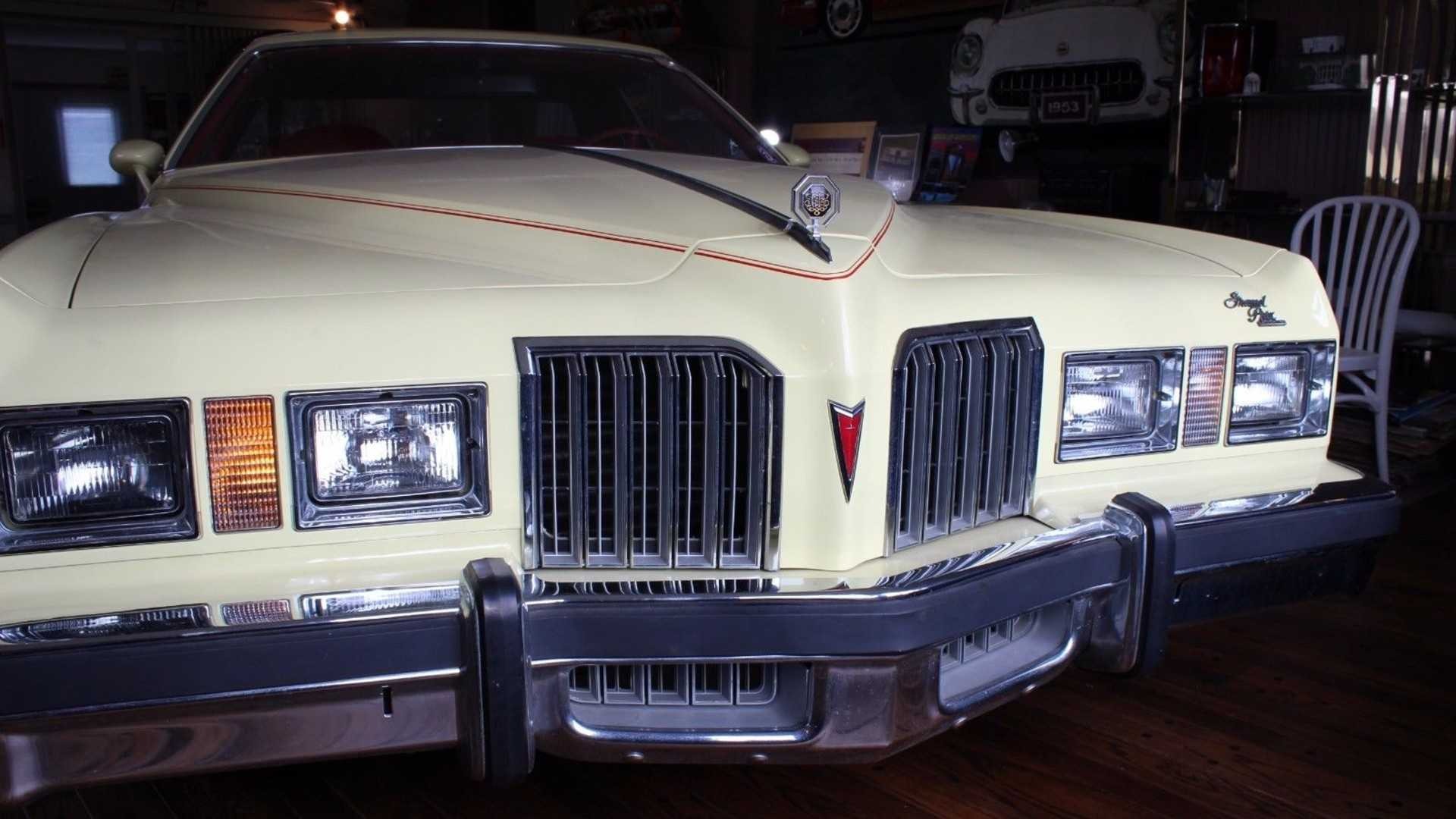 """[""""1977 Pontiac Grand Prix with only 123 miles from new""""]"""
