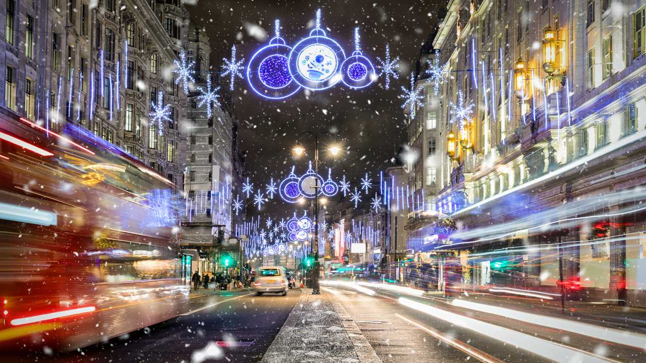 Regents Street in London with christmas lights and snowfall