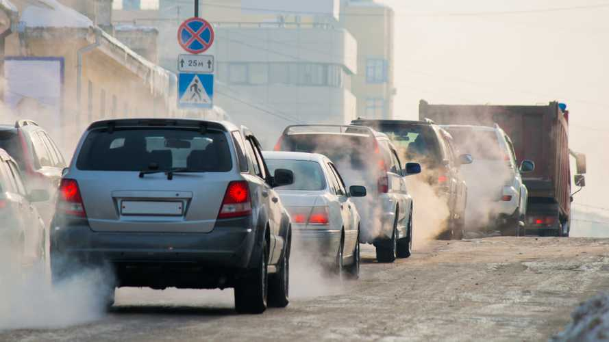 Car exhaust fumes in traffic during winter