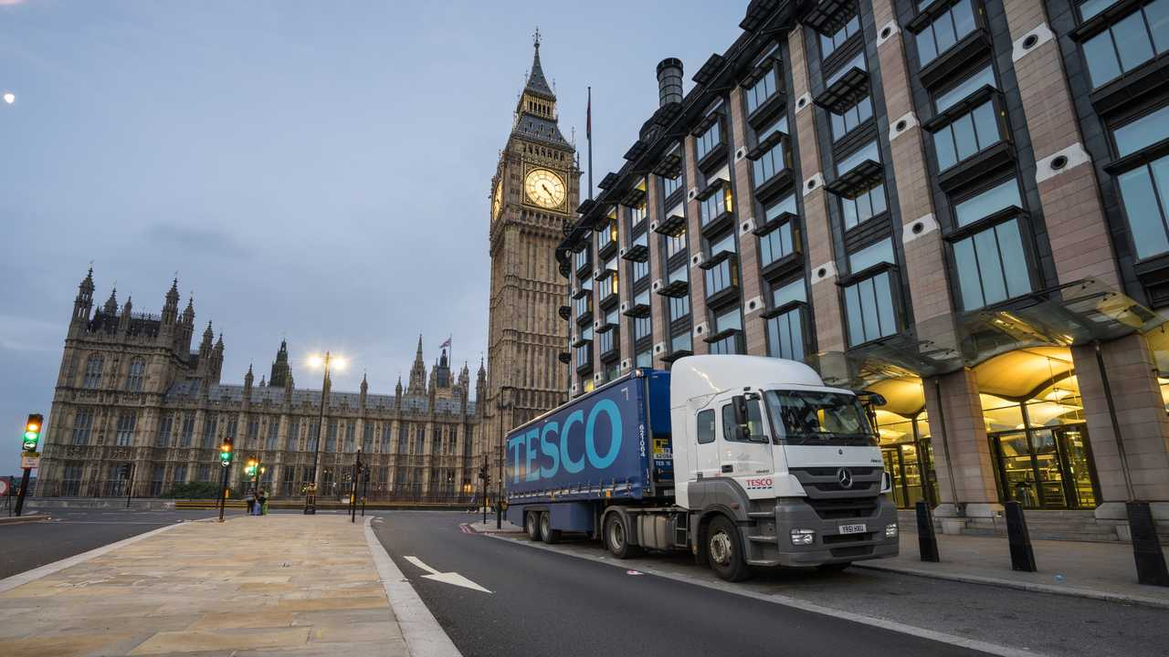 Tesco lorry in front of Big Ben during delivery at Victoria Embankment street