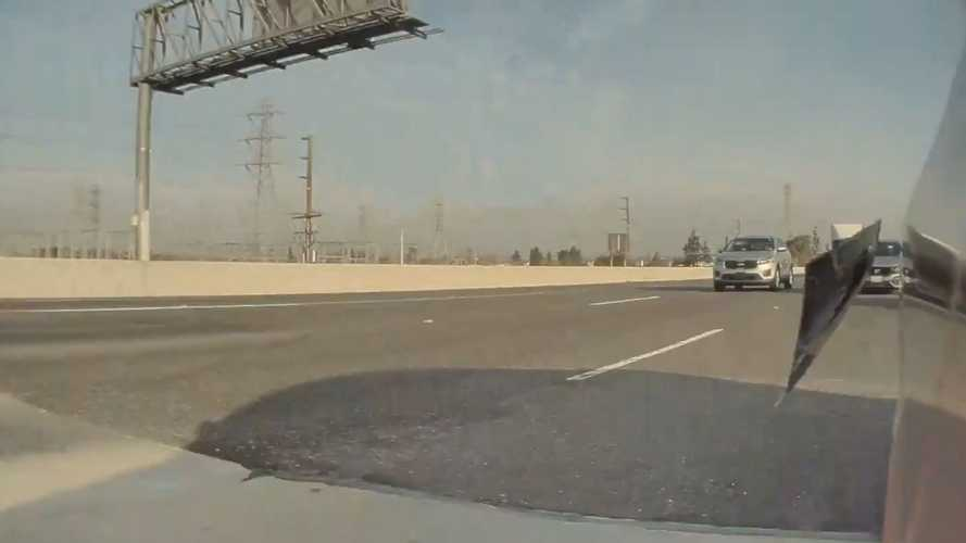 Watch This Tesla's Rear Window Fall Right Out On The Highway