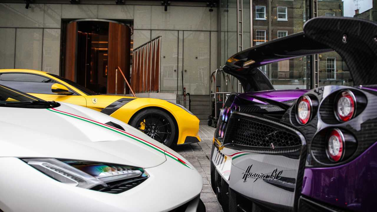 Lamborghini Centenario, Pagani Huayra BC and Ferrari F12tdf parked at hotel in London