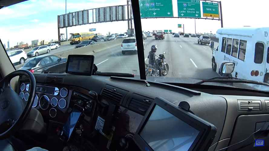 Watch This Trucker Help a Stranded Rider on a Busy Freeway