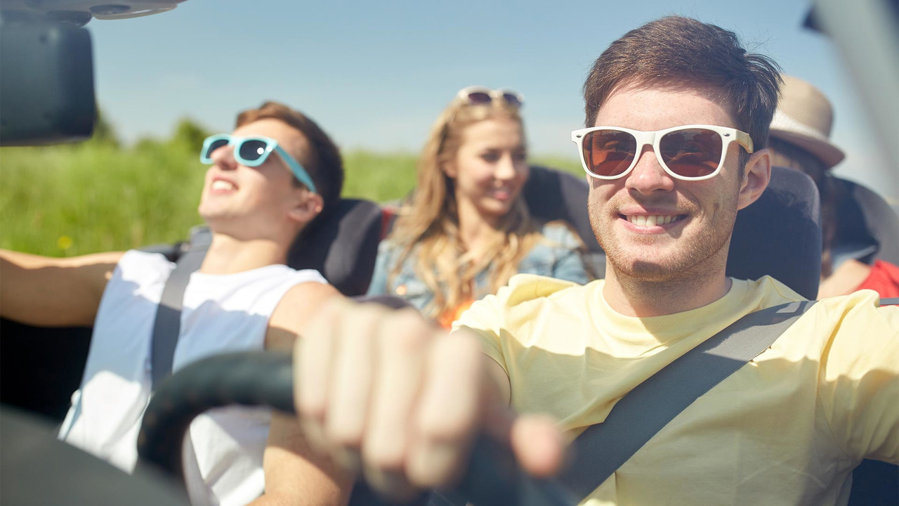 Teenagers in car on road trip