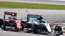 (L to R)- Kimi Raikkonen, Ferrari SF16-H and Nico Rosberg, Mercedes AMG F1 W07 Hybrid make contact as they battle for position