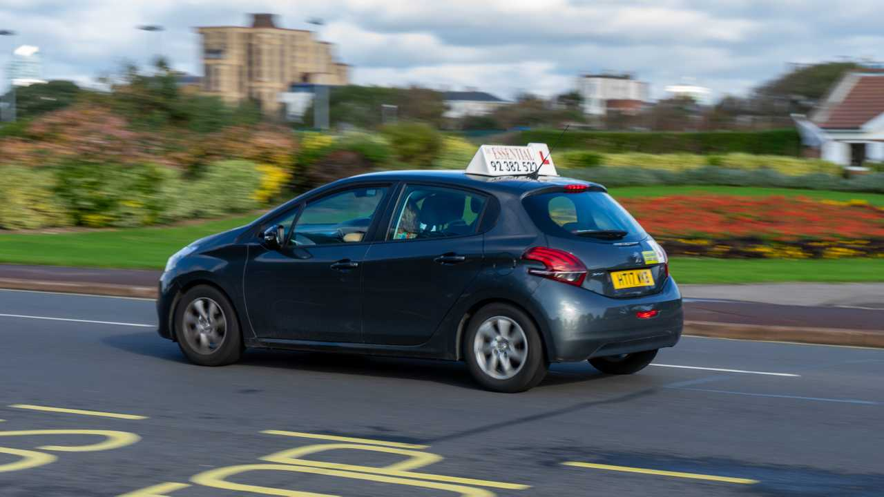 Driving instructors car with the learner driving in Portsmouth Hampshire UK