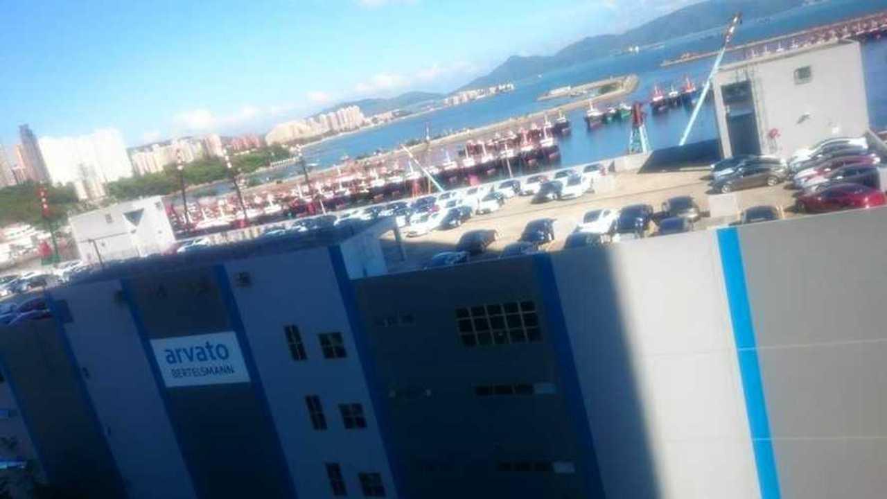 Shipment of Tesla Model S Seen On Warehouse Roof In Hong Kong
