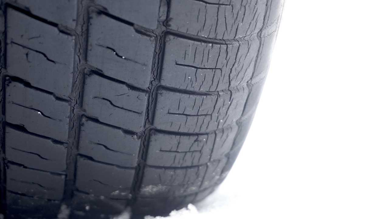 Worn car tyre on snow