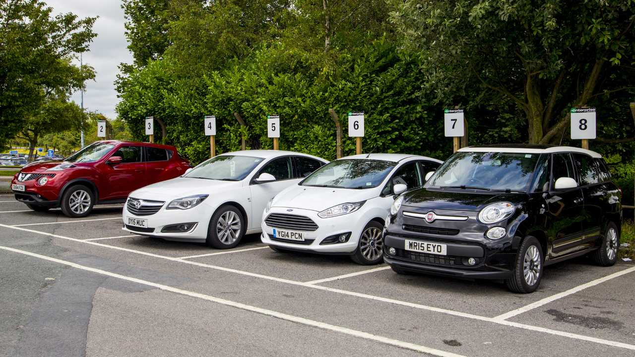 Line of hire cars parked at Enterprise car rental desk in Leeds Bradford Airport