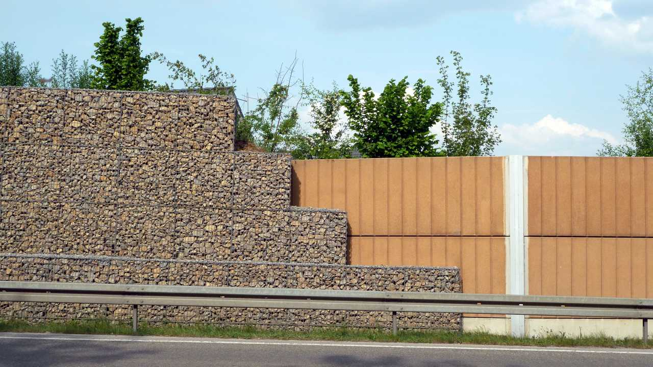 Noise barrier rock wall on motorway