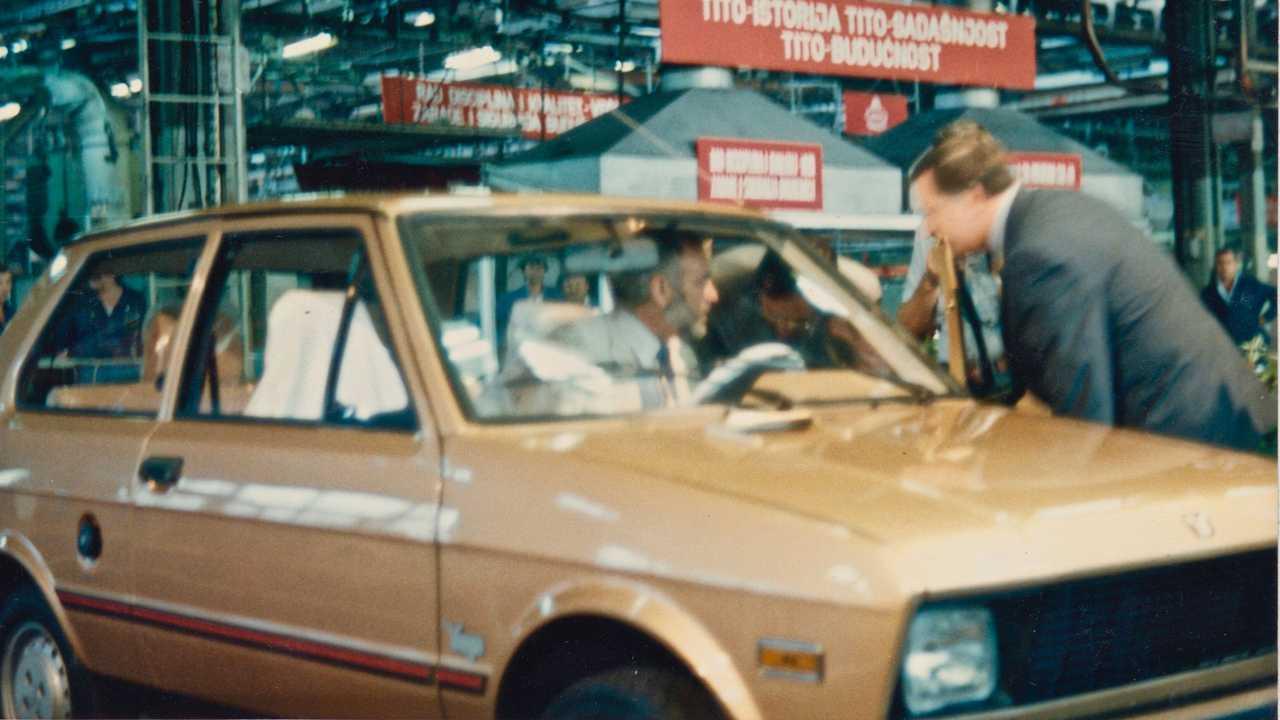 Malcolm Bricklin sitting in a new Yugo at Zastava's Yugoslavia plant in 1985.