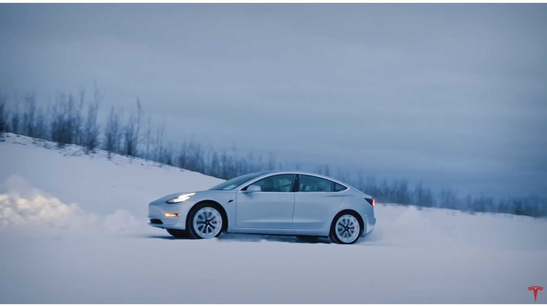 tesla model 3 performance navigational road rally at night in snow.