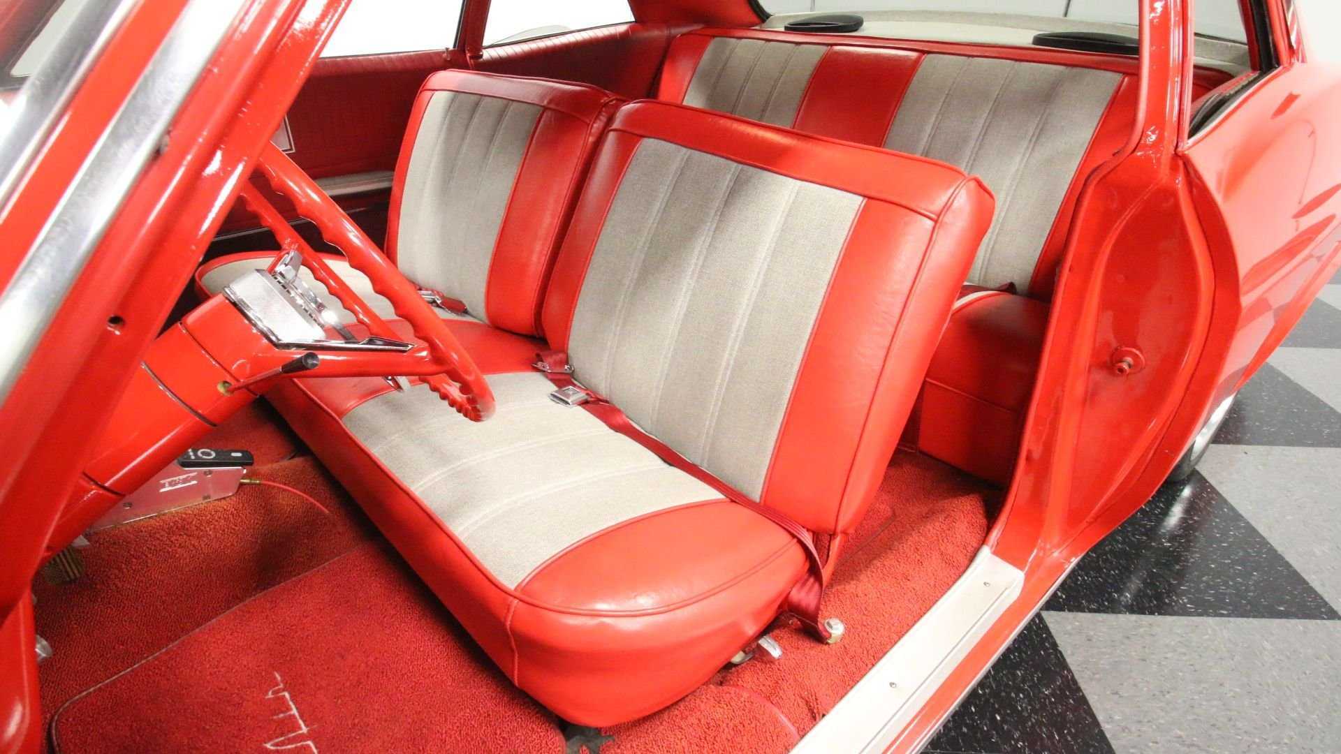 """[""""Classic 1965 Chevrolet Bel Air Stuns In A Glossy Red Coat""""]"""