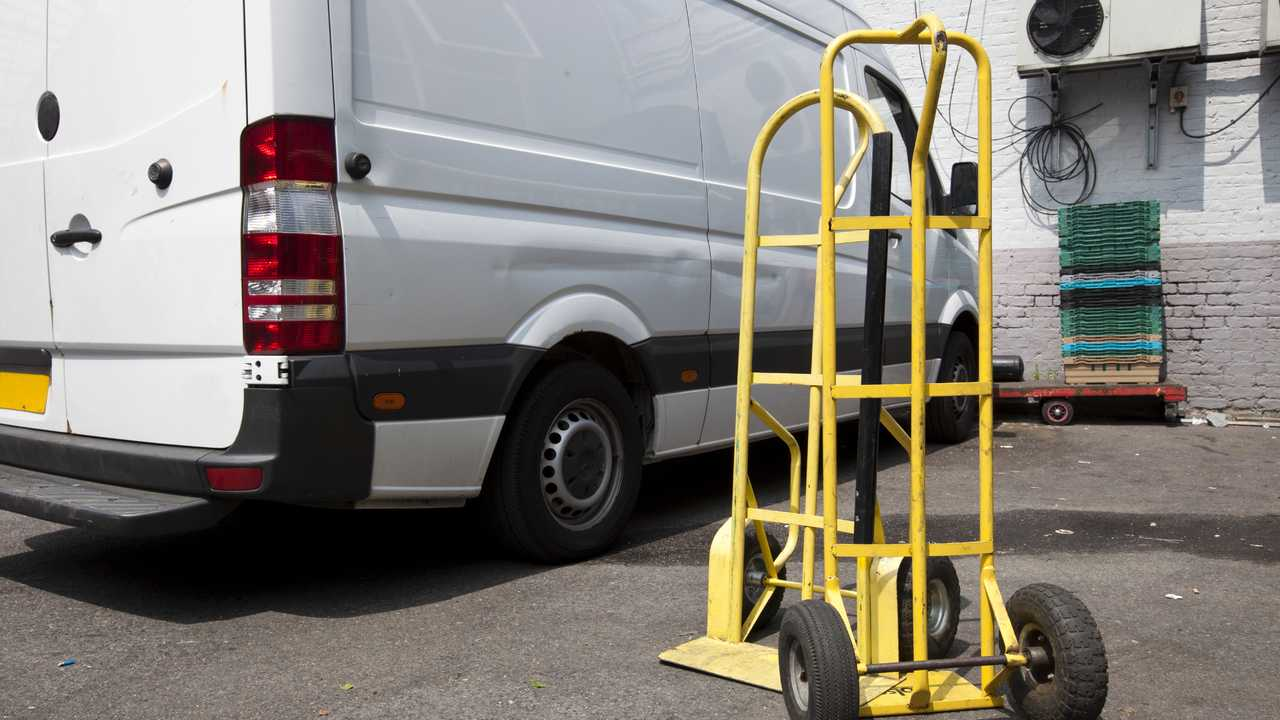 Trolley and van outside warehouse