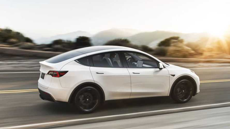 tesla model y white driving