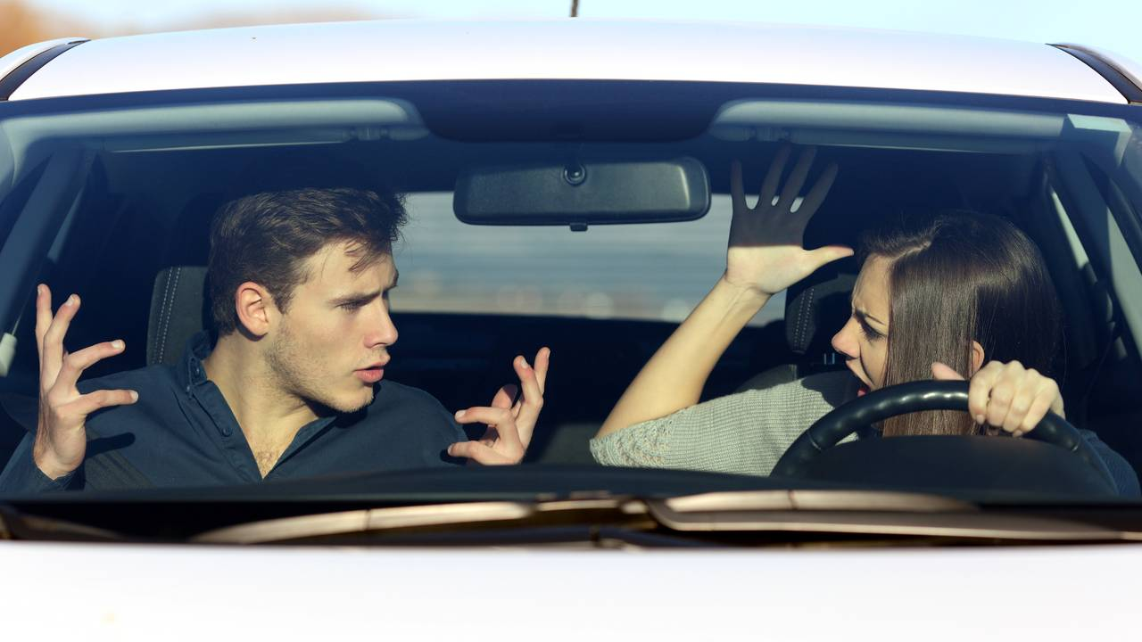 Couple arguing while driving in a dangerous situation