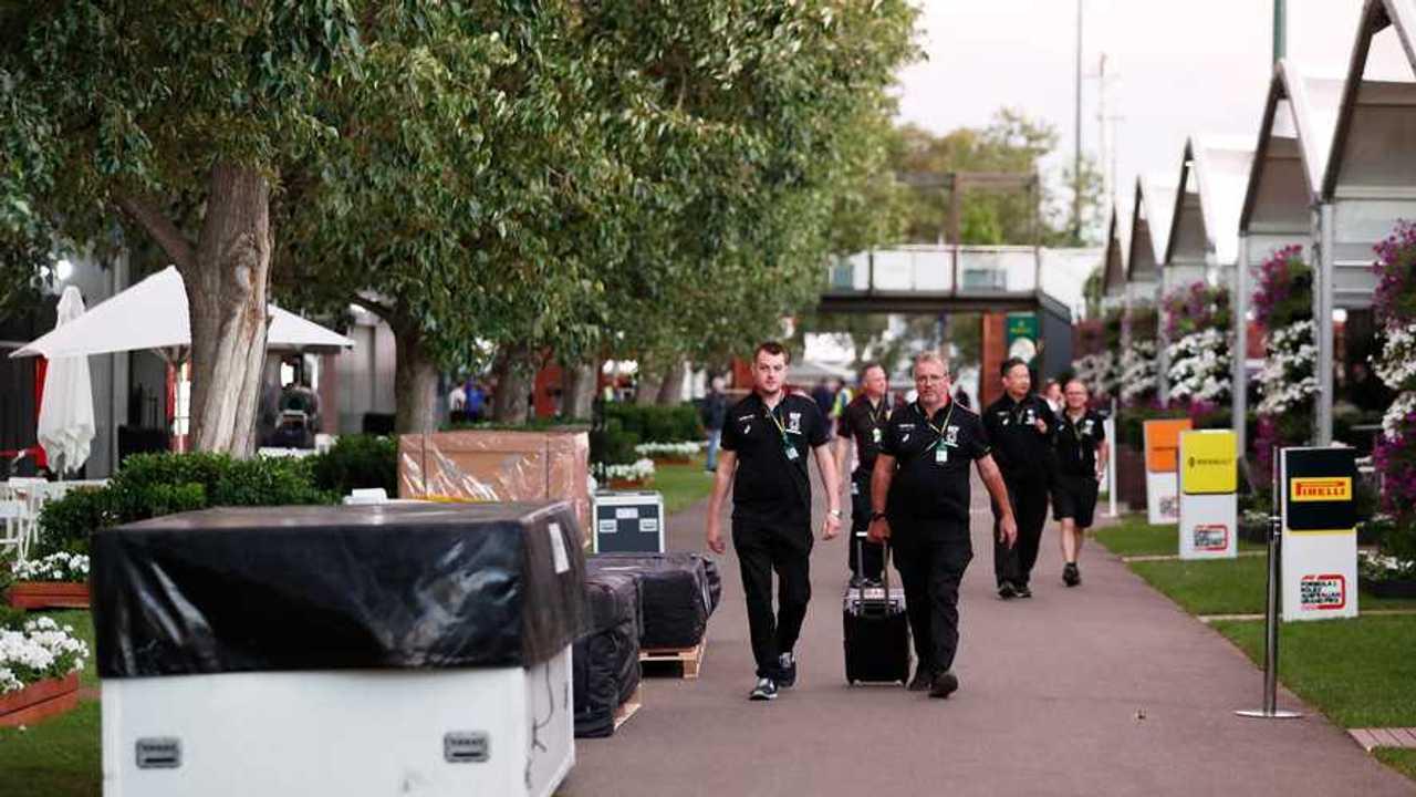 AlphaTauri Honda staff in the paddock amongst packing crates