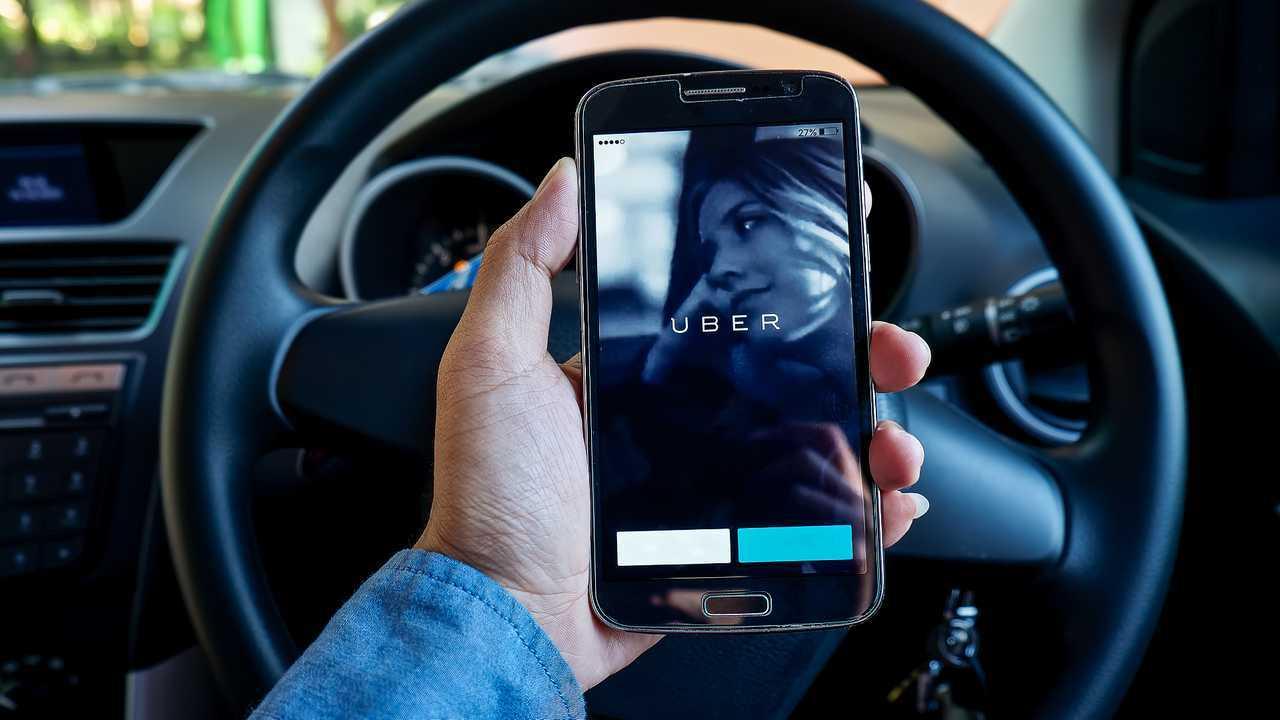 Driver using Uber app on smartphone