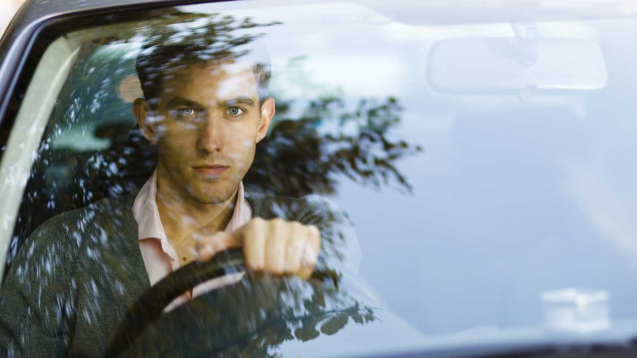 Driver looking attentively through windscreen