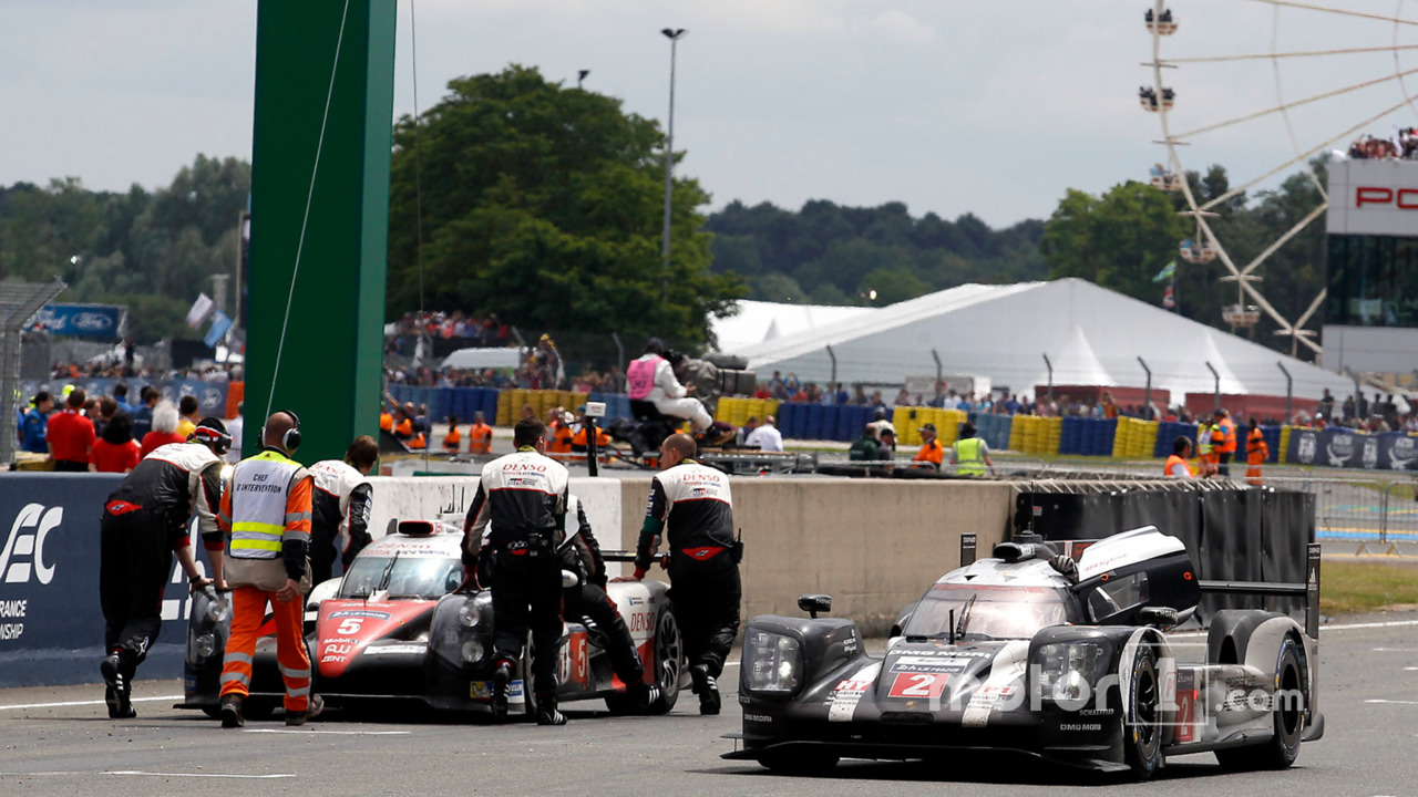 Winning car #2 Porsche Team Porsche 919 Hybrid passed the #5 Toyota Racing Toyota TS050 Hybrid