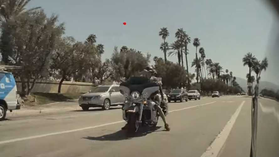 Watch Motorcycle rider throw rock at Tesla Model Y