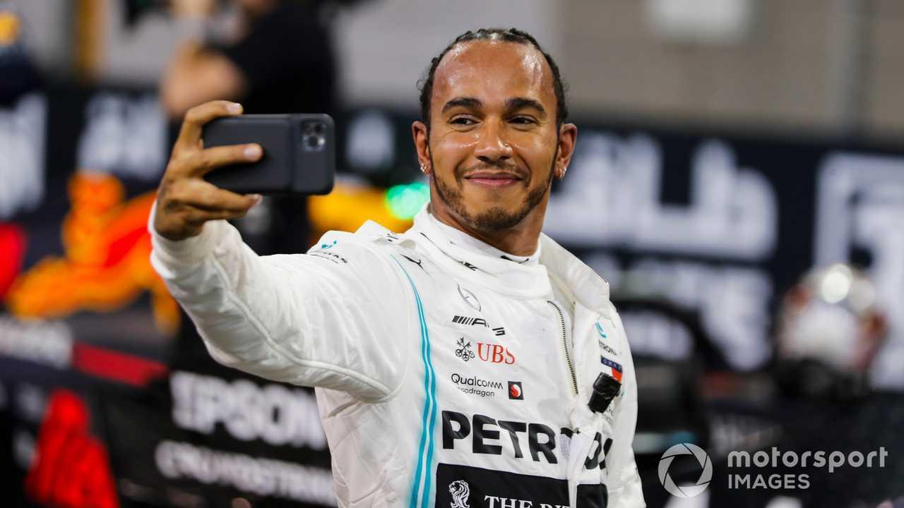 Lewis Hamilton celebrating pole position with selfie at Abu Dhabi GP 2019