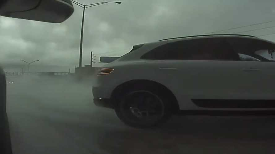 Watch TeslaCam capture a Porsche Macan hydroplaning and hitting wall
