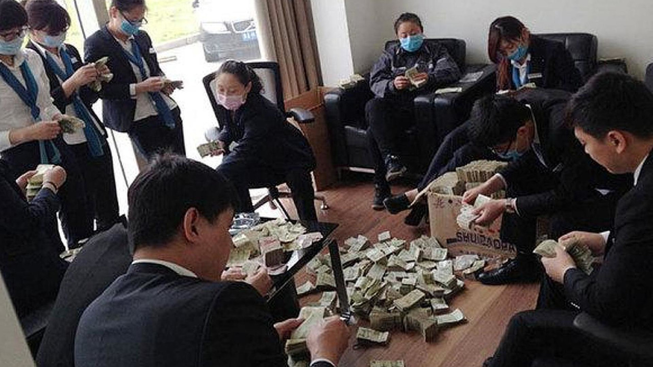 BMW employees counting money