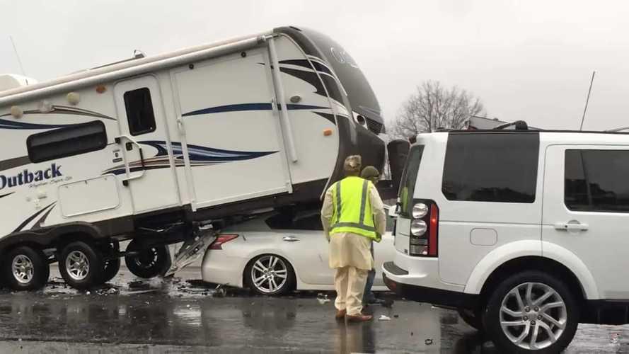 Nissan slides completely under camper trailer in crazy crash