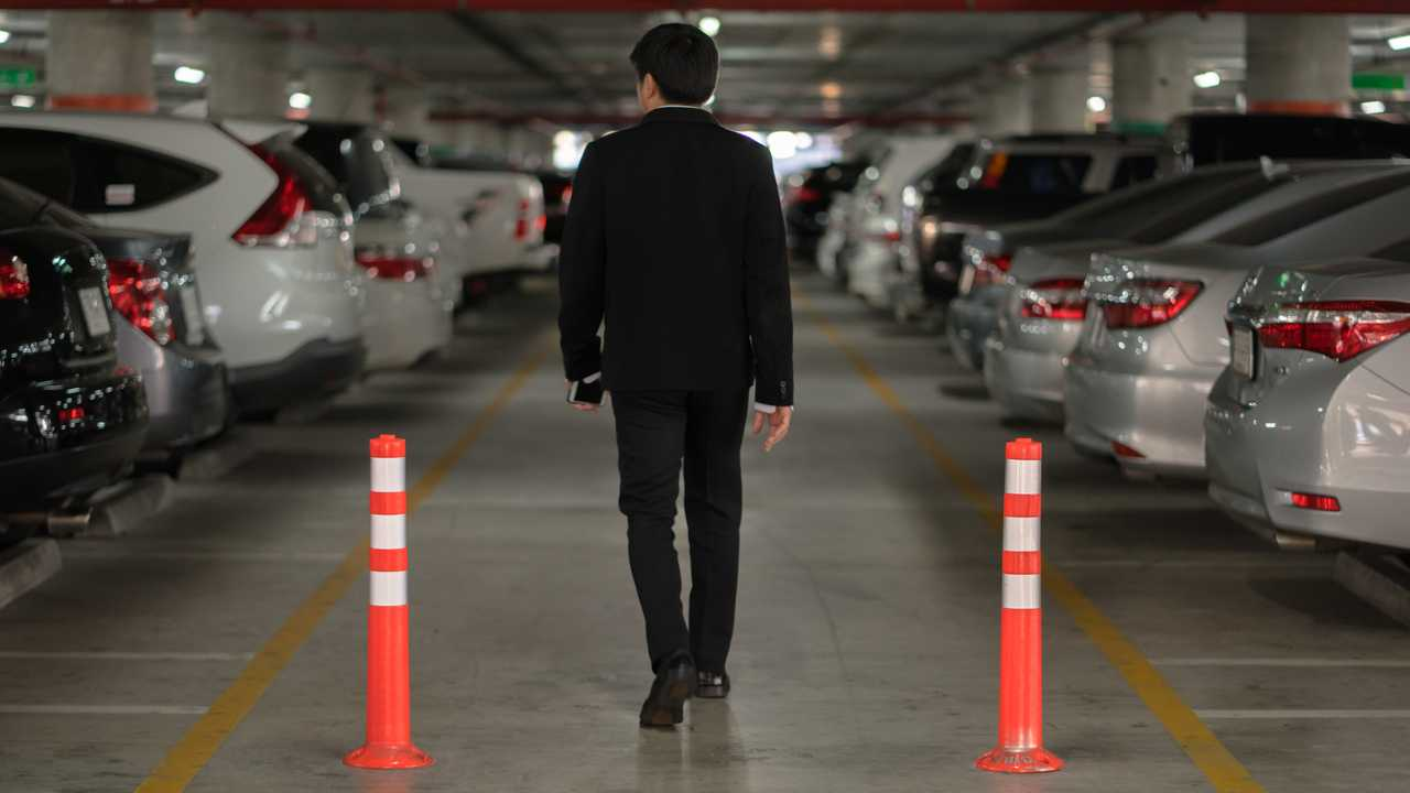 Man looking for car in airport parking