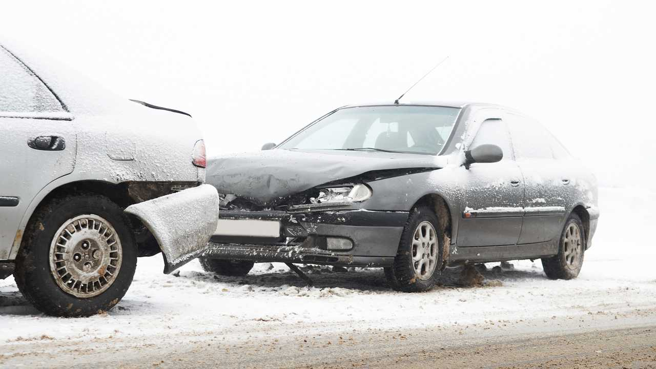 Winter car accident on snow covered road