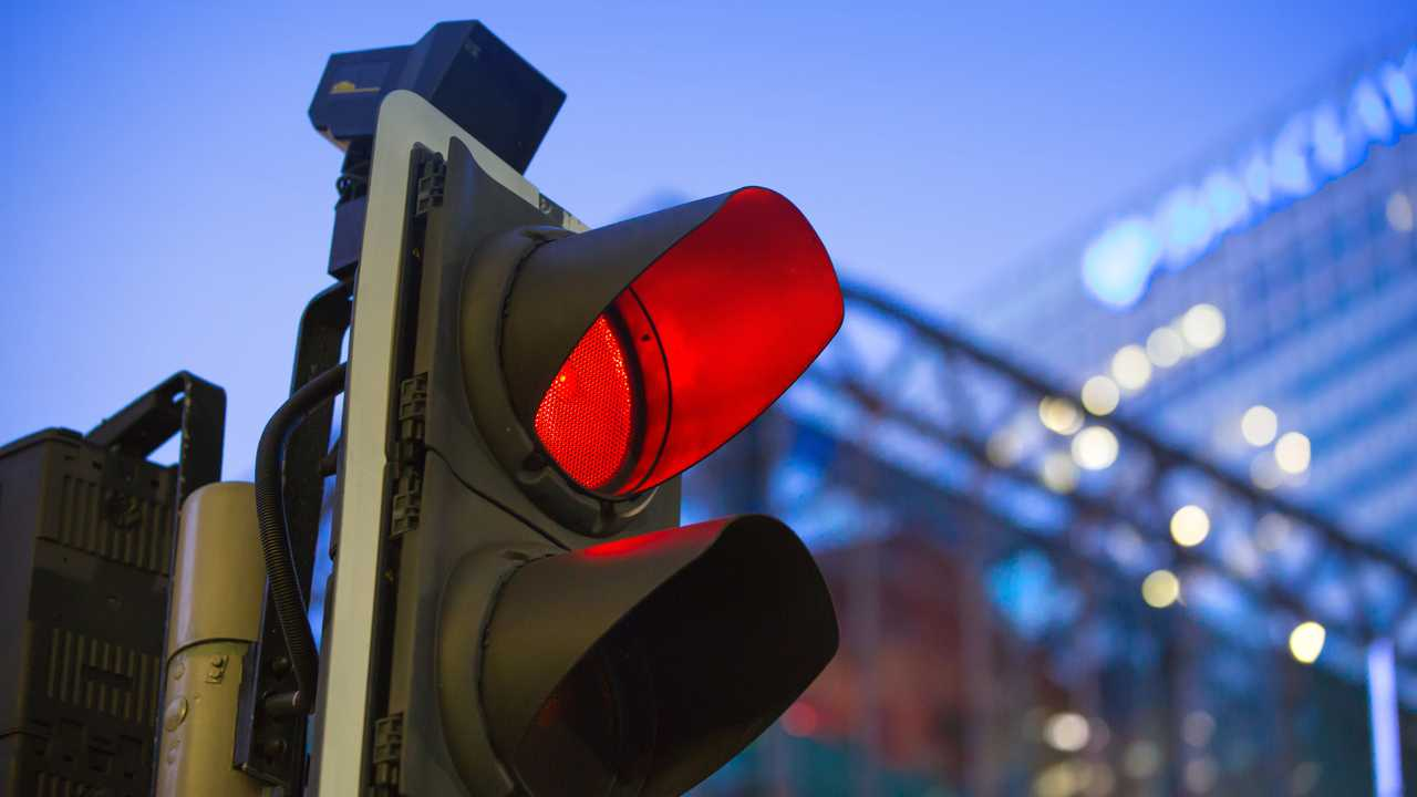 London's Canary Wharf traffic light showing red