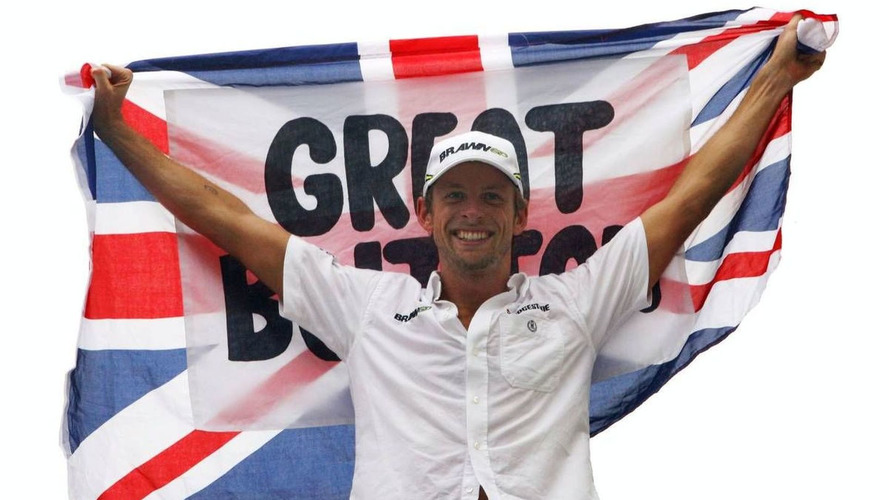 Button celebrated title alone in hotel