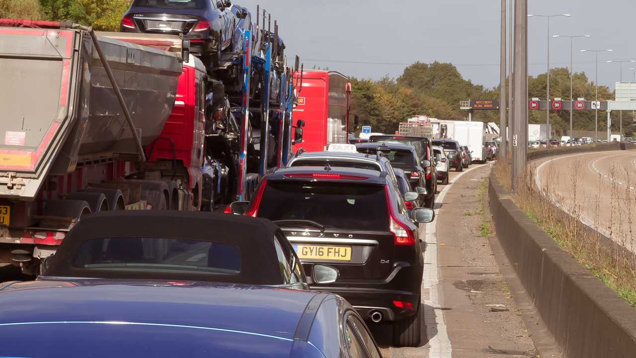 Cars queuing in traffic jam on M25 orbital motorway around London