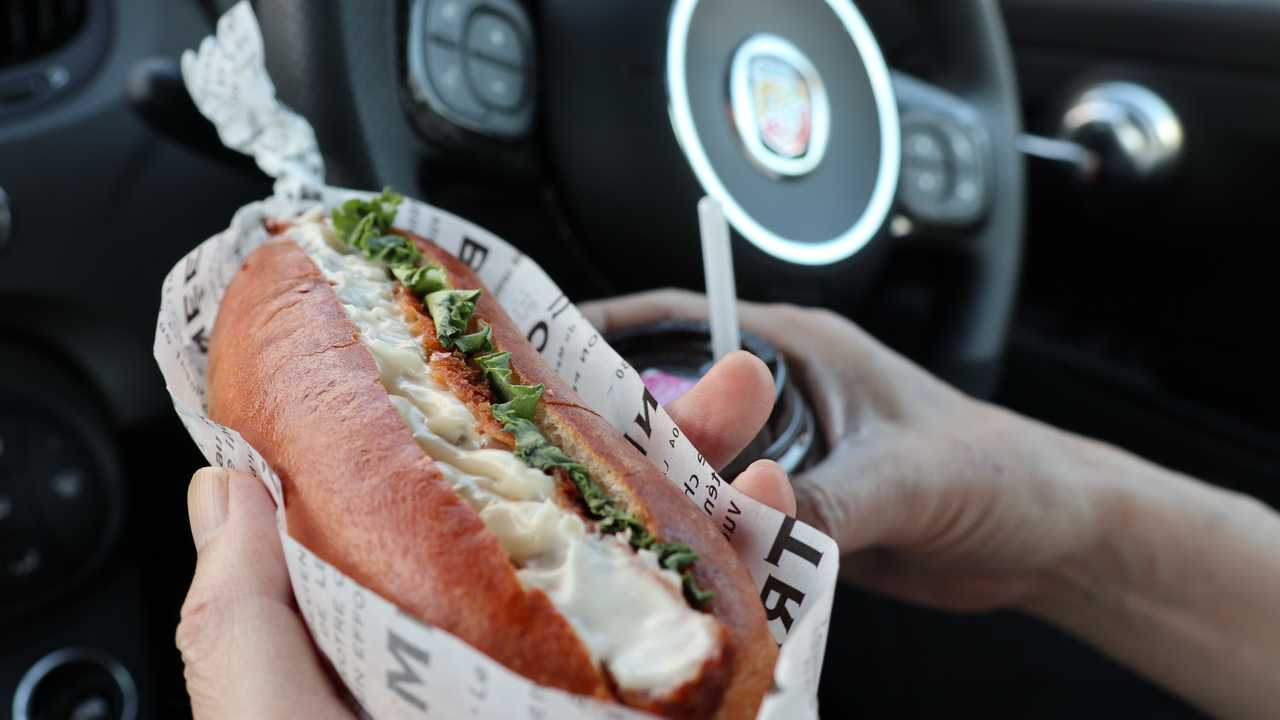 Driver eating fast food in car