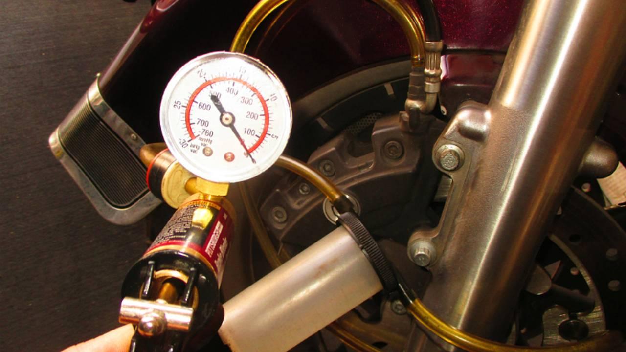 Vacuum hand pump can speed brake bleeding.