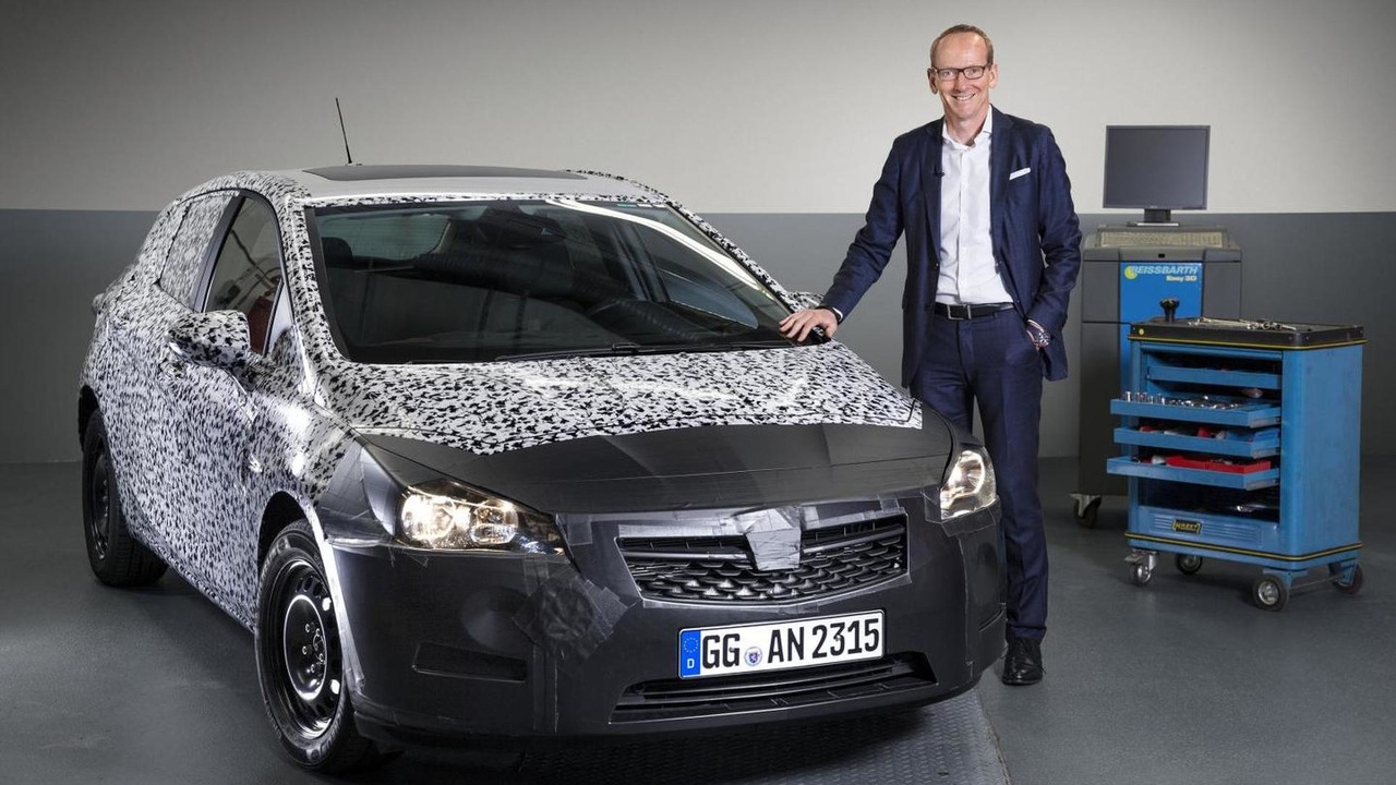 Opel Group CEO Dr. Karl-Thomas Neumann presents a heavily camouflaged all-new next generation Astra prototype