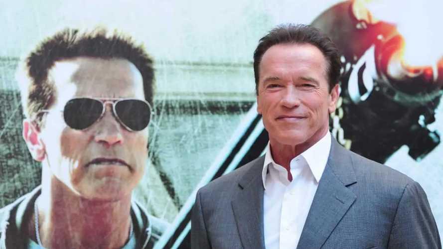 Arnold Schwarzenegger Shown Lifting A Ford F-150 Lightning