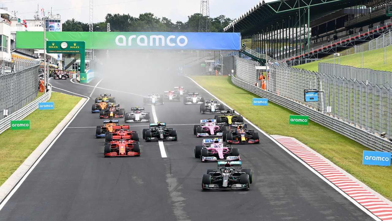 Lewis Hamilton, Mercedes F1 W11 leads Lance Stroll, Racing Point RP20 and Sebastian Vettel, Ferrari SF1000 at the start of the race
