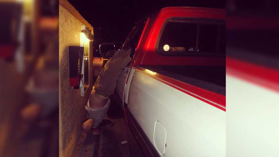 Police Find Dumb Drunk Driver Hanging From His Truck Window