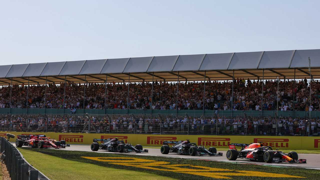 Max Verstappen, Red Bull Racing RB16B, Lewis Hamilton, Mercedes W12, Valtteri Bottas, Mercedes W12, and Charles Leclerc, Ferrari SF21