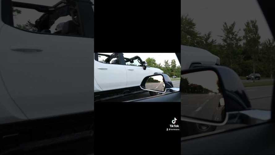 Watch Tesla Model 3 Race GMC Hummer EV Prototype